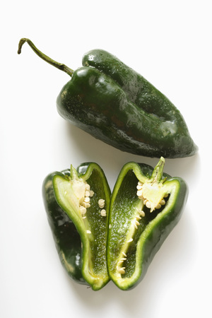 pimiento: Green peppers (Poblano from Mexico), whole and halved LANG_EVOIMAGES