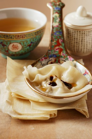 tons: Won tons on spoon; clear broth in small bowl