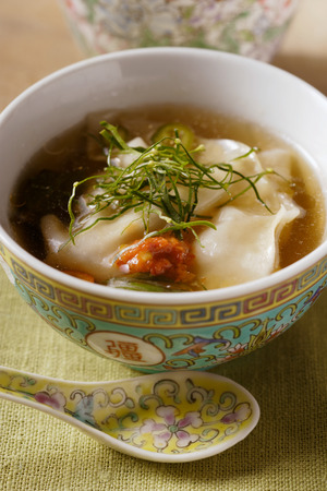 chili sauce: Broth with won tons, chili sauce & strips of lemon leaves LANG_EVOIMAGES