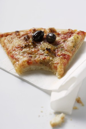 are taken: Piece of pizza with tuna and olives, a bite taken LANG_EVOIMAGES