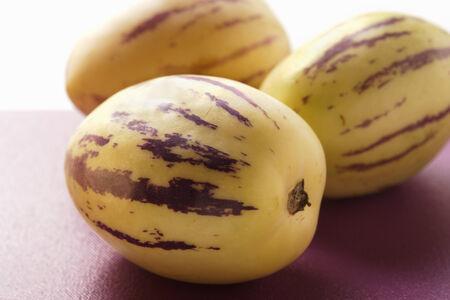 pepino: Three pepino melons on purple background