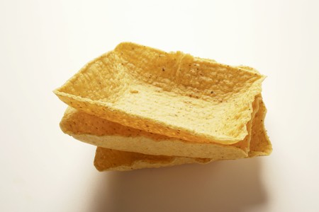 nibbles: Square taco shells, in a pile