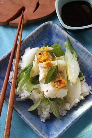 spring onions: Cod with spring onions and orange sauce on rice