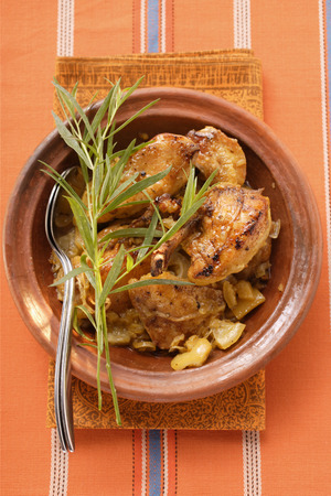 moroccan cuisine: Braised chicken with onions and tarragon in tajine LANG_EVOIMAGES