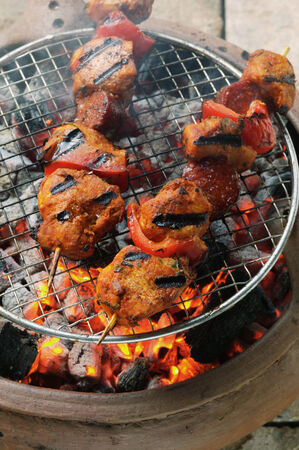 broiling: Spicy pork kebabs on the barbecue