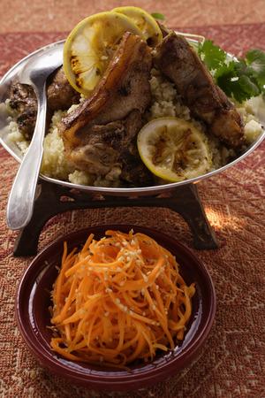 couscous: Lamb cutlets with couscous; carrot salad with sesame LANG_EVOIMAGES