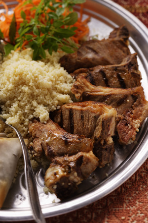 couscous: Grilled lamb cutlets with couscous and raw carrot salad LANG_EVOIMAGES