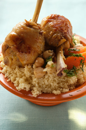 couscous: Chicken legs and vegetables on couscous
