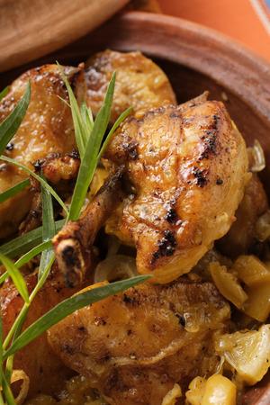 Braised chicken with onions in tajine