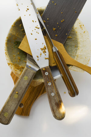 implements: Various serving implements and baking dish on chopping board