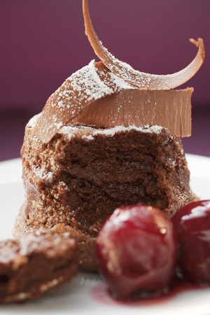 chocolate curls: Chocolate soufflé with chocolate curls and cherries LANG_EVOIMAGES