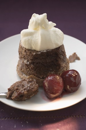 ovenbaked: Chocolate soufflé with cream and cherries