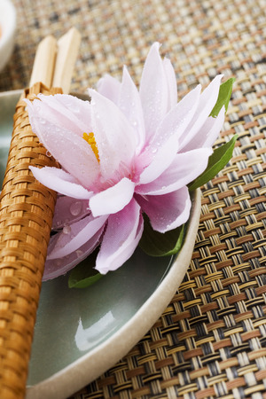 nymphaea odorata: Place setting with water lily and chopsticks (Asia)