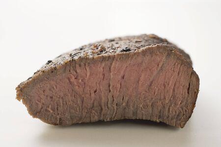 cut off: Beef steak with a piece cut off