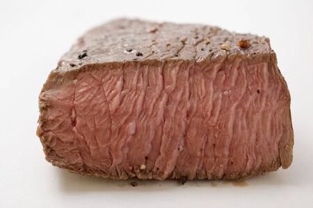cut off: Beef steak, a piece cut off LANG_EVOIMAGES