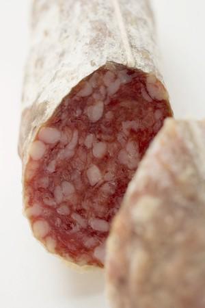 cut off: Italian salami with a piece cut off