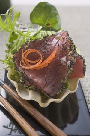 tunafish: Raw tuna fillet with poppy seeds and salad garnish