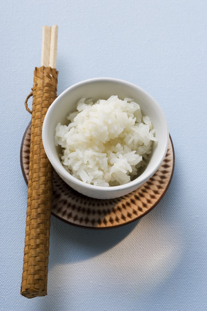 side order: Bowl of rice and chopsticks on plate