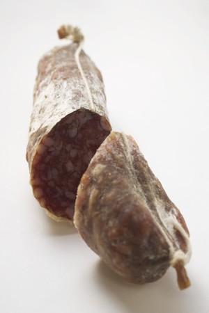 scored: Italian salami, cut in two