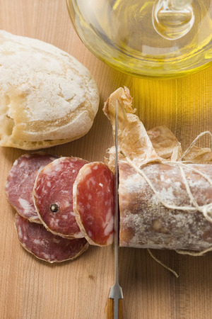 italian salami: Italian salami with slices cut, white bread, olive oil