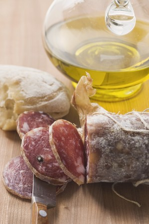 italian salami: Italian salami, partly sliced, white bread, olive oil