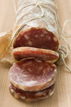 dry sausage: Italian salami with slices cut