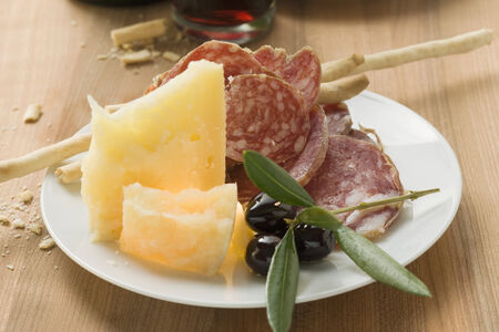 grissini: Salami, cheese, olives and grissini on plate LANG_EVOIMAGES