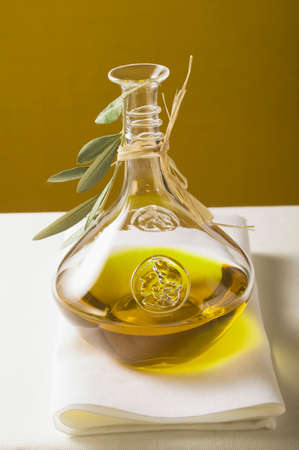 carafe: Olive oil in carafe with olive branch
