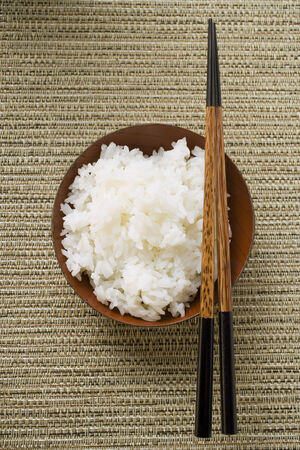 side order: Bowl of rice and chopsticks