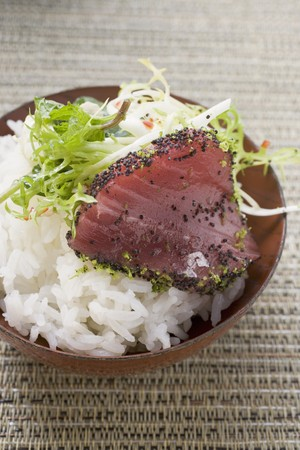 tunafish: Raw tuna fillet with poppy seeds on rice