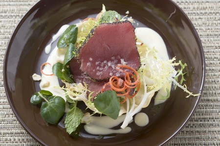 tunafish: Raw tuna fillets with poppy seeds on salad in bowl