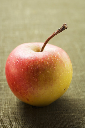 redness: Fresh apple with drops of water