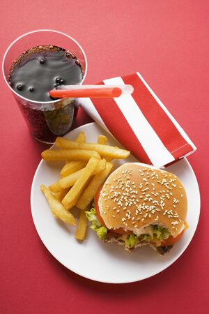 all american burger: Cheeseburger, bites taken, with chips and Cola