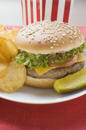 all american burger: Cheeseburger with potato crisps and gherkin