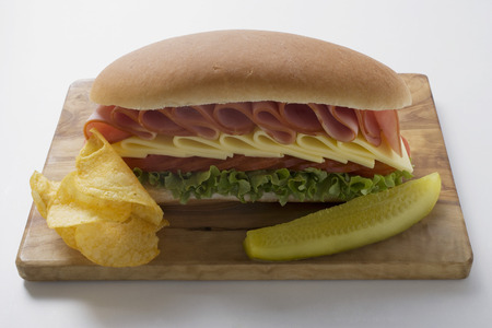 hero sandwich: Sub sandwich with crisps and gherkin LANG_EVOIMAGES