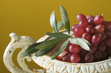 redness: Red grapes with olive branch