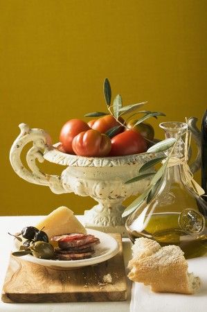 salame: Olives, sausage, Parmesan, bread, olive oil and tomatoes