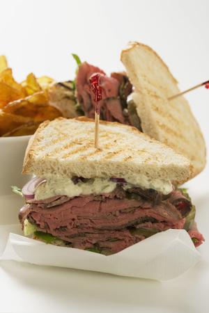 crisps: Roast beef sandwiches with crisps