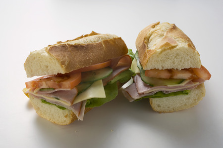 hero sandwich: Baguette with ham, cheese, tomato, cucumber (halved) LANG_EVOIMAGES