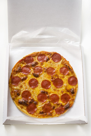 pizza box: Whole salami and cheese pizza in pizza box