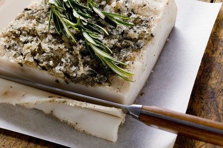 bacon fat: Bacon fat from Tuscany with rosemary, a slice being cut