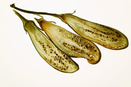 backlit: Deep-fried aubergine slices, backlit