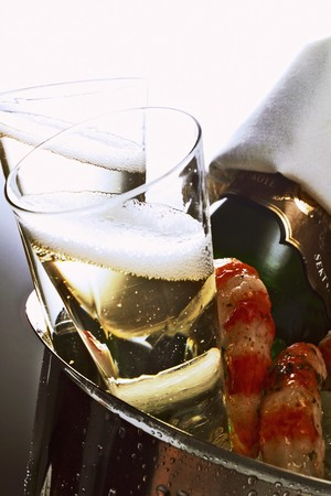 champers: Two champagne glasses & bottle & shrimps in champagne bucket LANG_EVOIMAGES