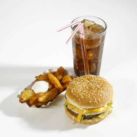 potato wedges: Cheeseburger, potato wedges and cola