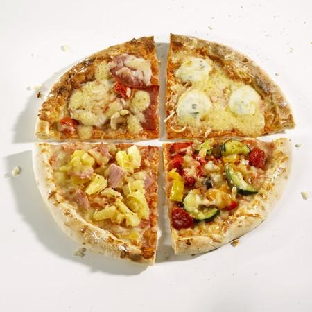 quartered: Quarters of four different pizzas