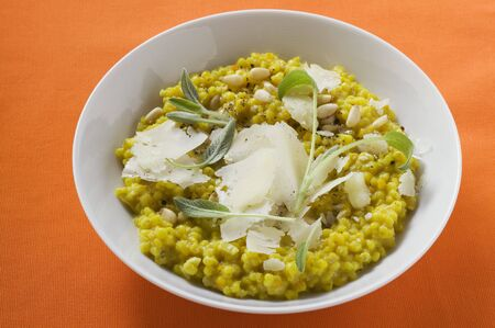 pine kernels: Risotto with sage, pine nuts and Parmesan LANG_EVOIMAGES