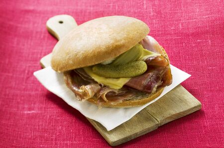 bread roll: Bread roll with raw ham, cheese and gherkins
