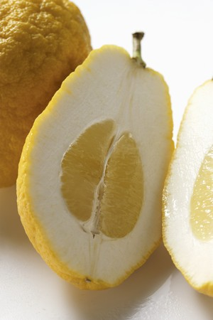 citrons: Citrons, whole and halved (close-up)