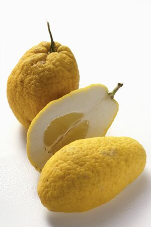 citrons: Citrons, whole and halved LANG_EVOIMAGES