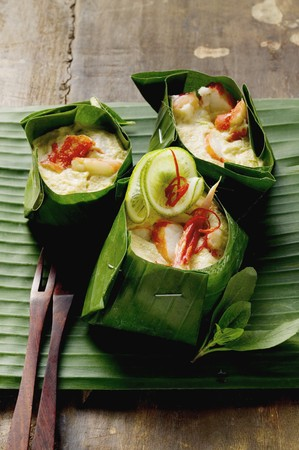coconut crab: Crabmeat with coconut sauce in banana leaf